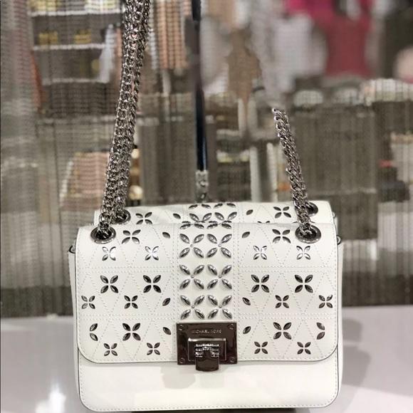 dc1d9435ea5f Michael kors medium Tina Flap crossbody bag